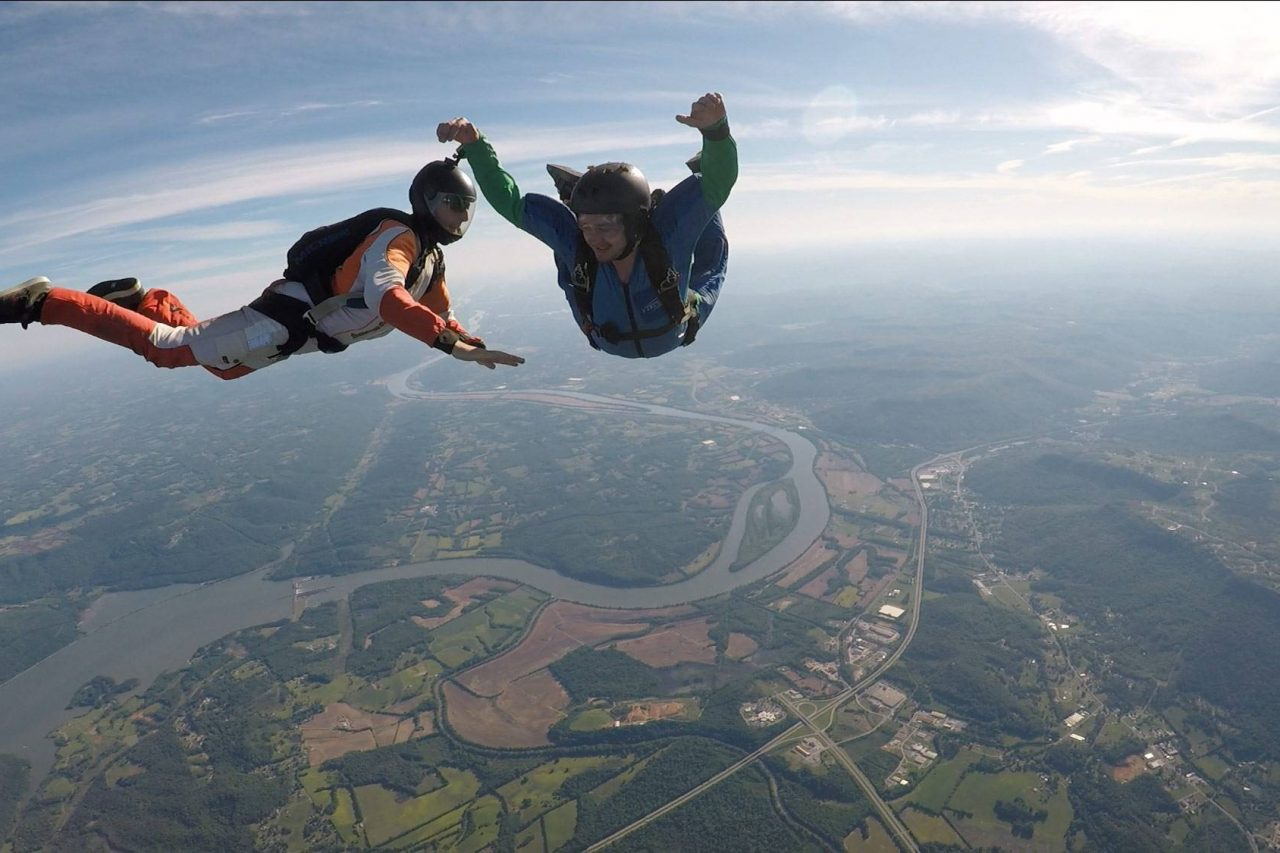 Man experiencing free fall during AFF training at the skydiving company