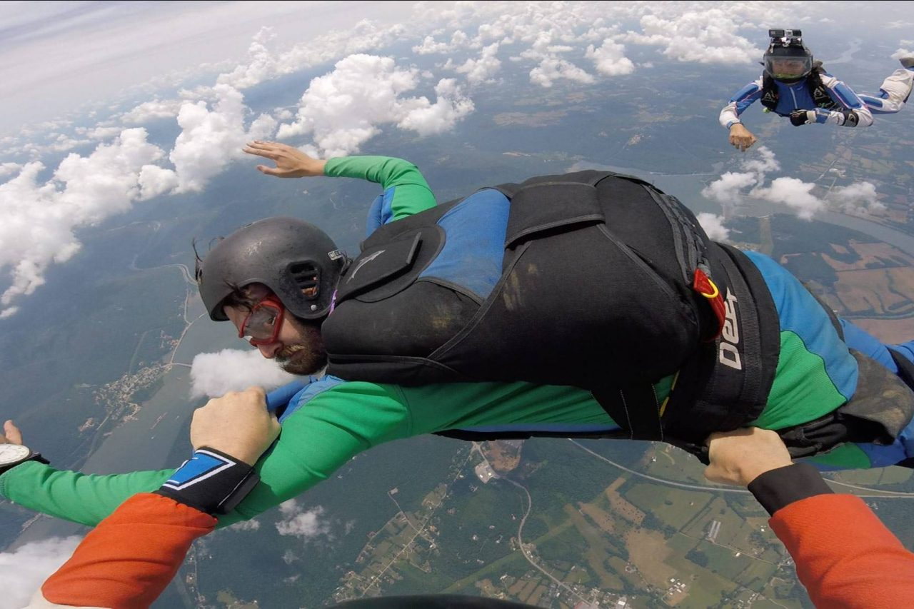 Man participating in hands on AFF training with the skydiving company instructors