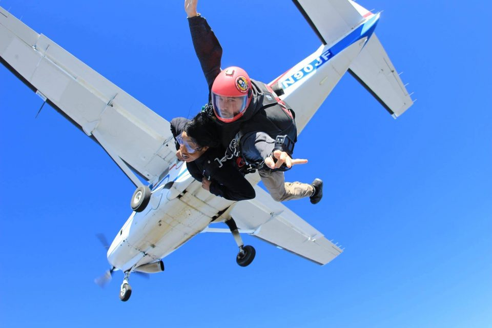 Tandem instructor experiencing the rush of free fall with student after leaping from the skydiving company aircraft