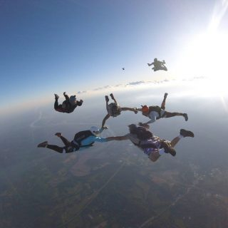 Experienced jumpers coming into formation during free fall at the skydiving company