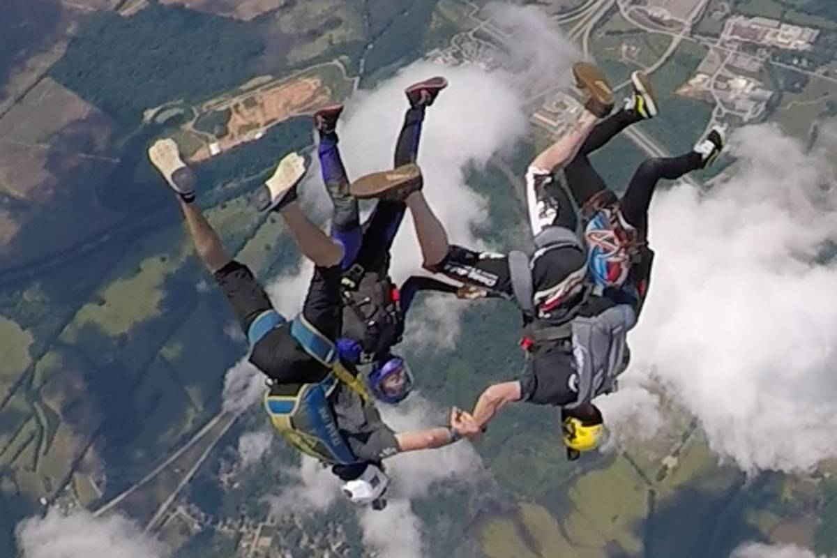 Experienced skydivers in a head down formation at the skydiving company