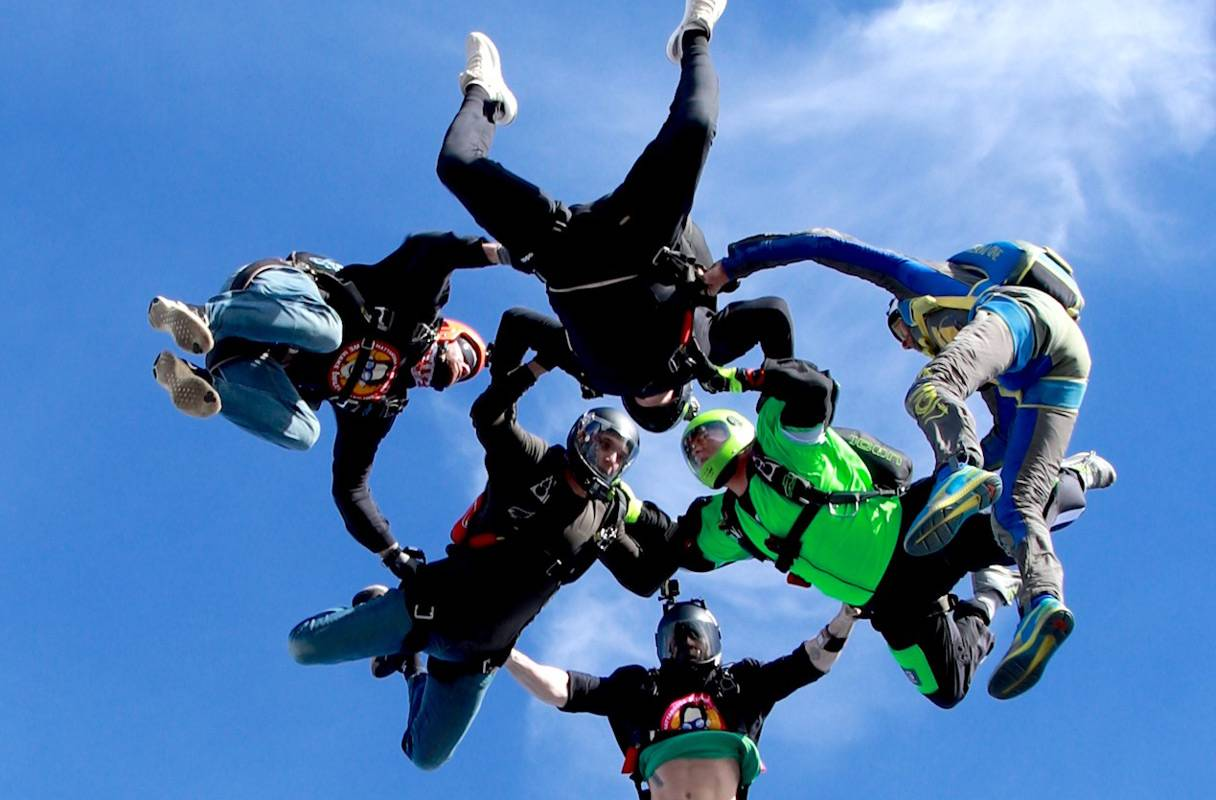 Experienced jumpers enjoying free fall at the skydiving company
