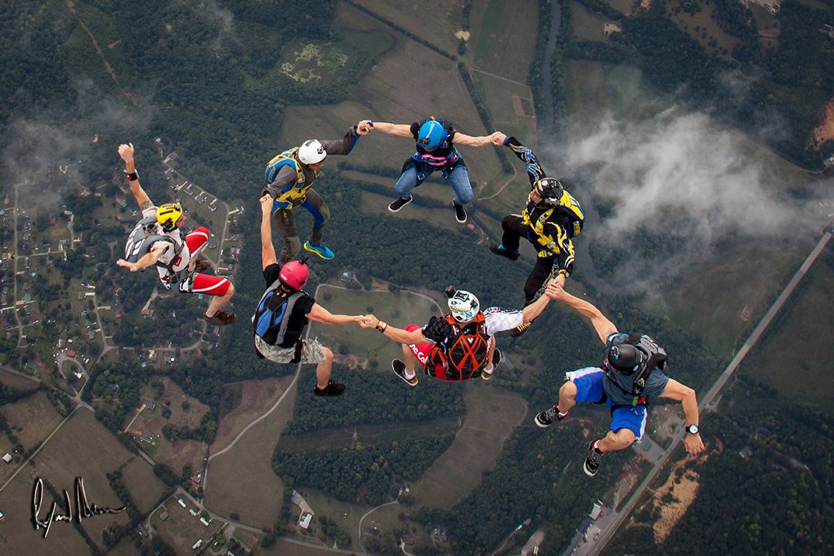 Experienced jumpers in a sit formation during free fall