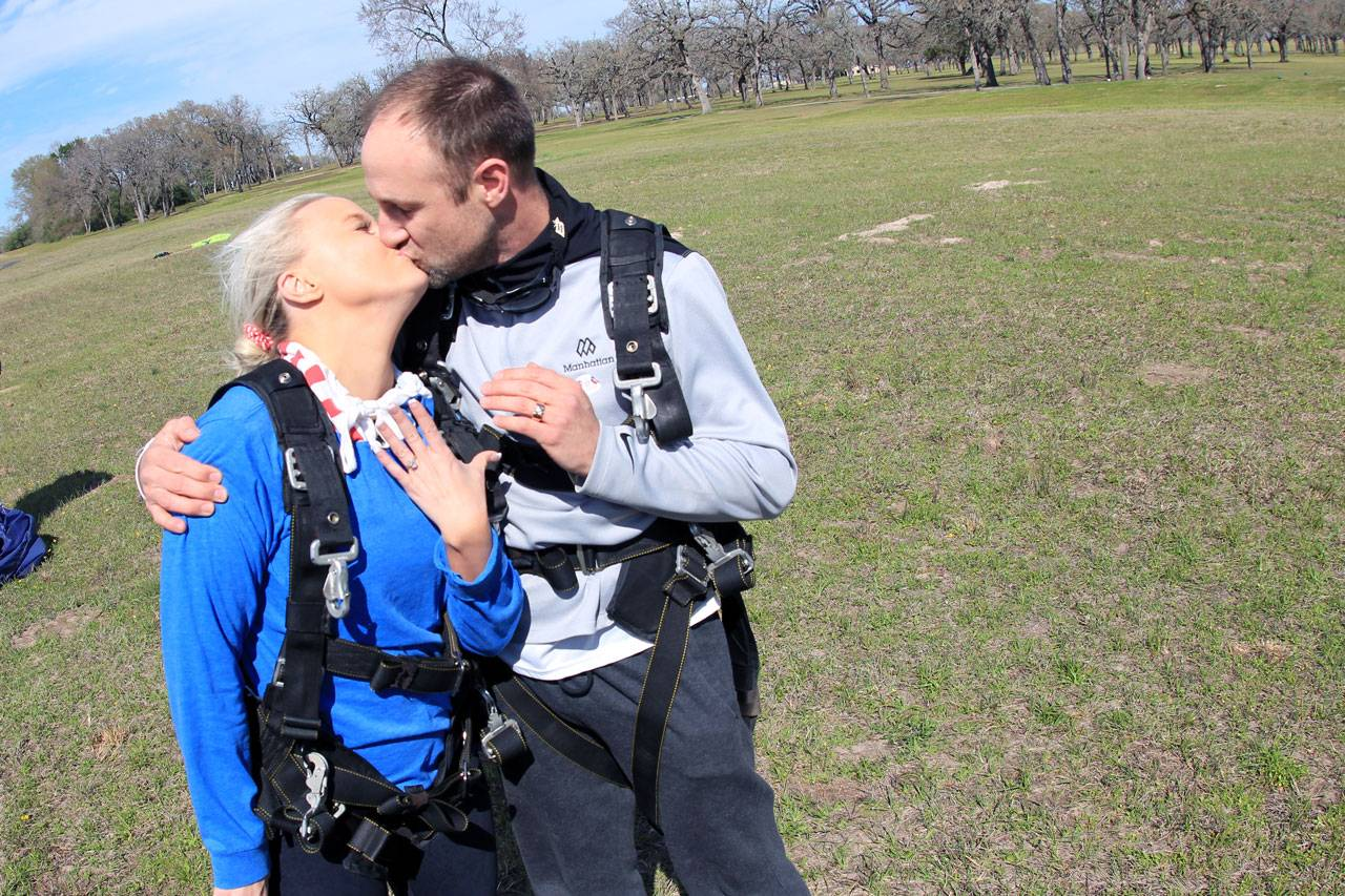 Man and women kiss in celebration of their recent engagement at The Skydiving Company